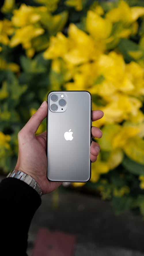 Close-Up Shot of a Person Holding an Iphone