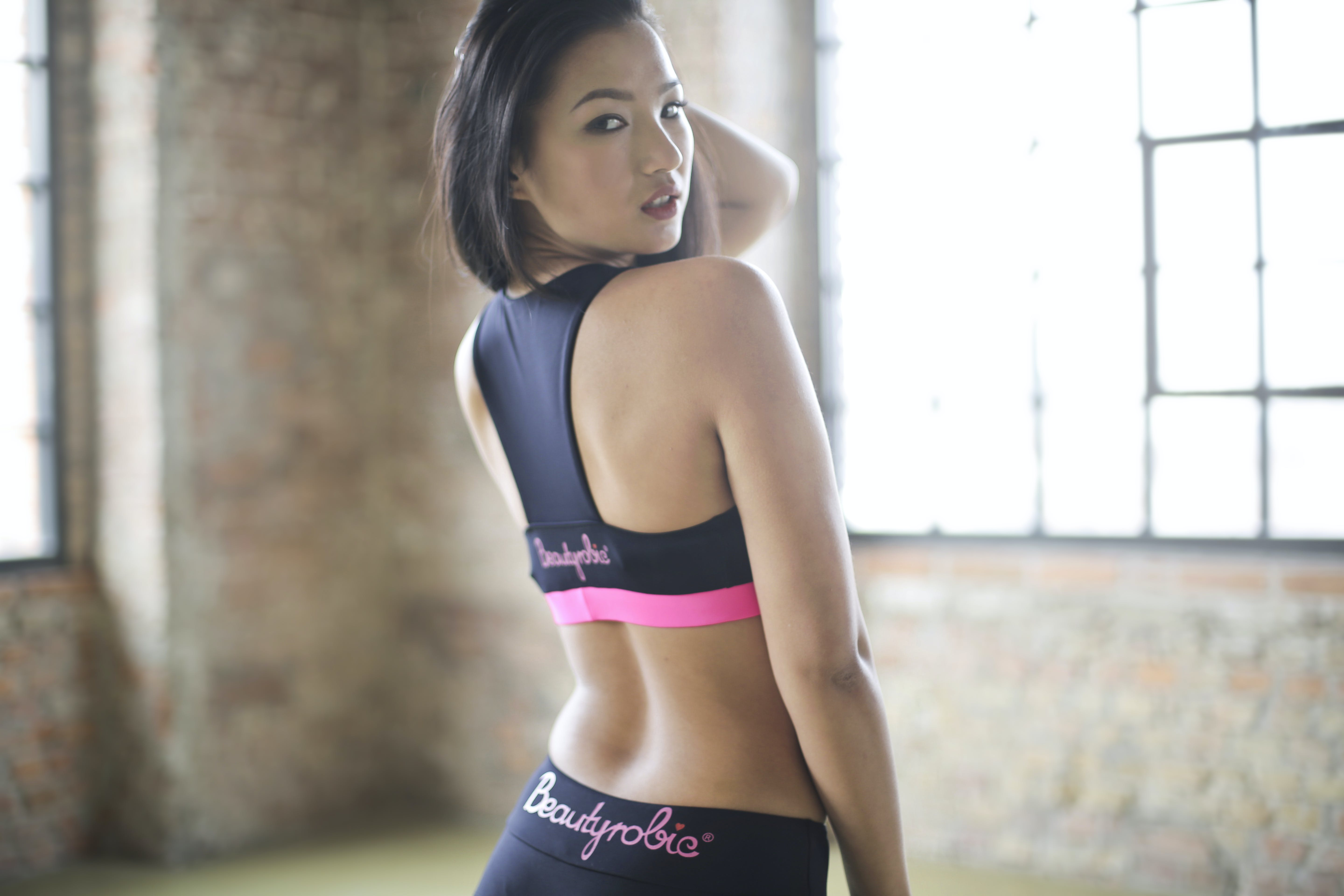 Woman in Black and Pink Sports Bra