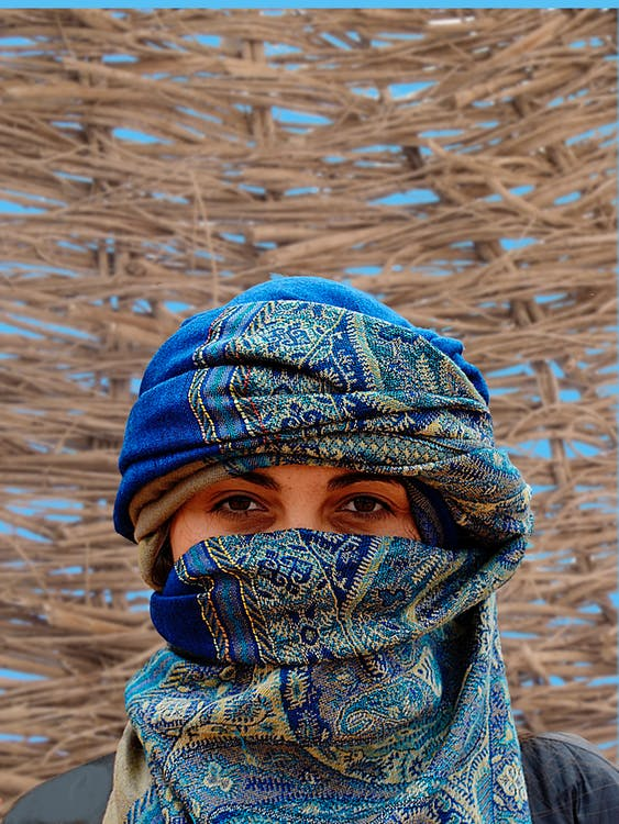 Person Wearing Blue and Brown Hijab Veil