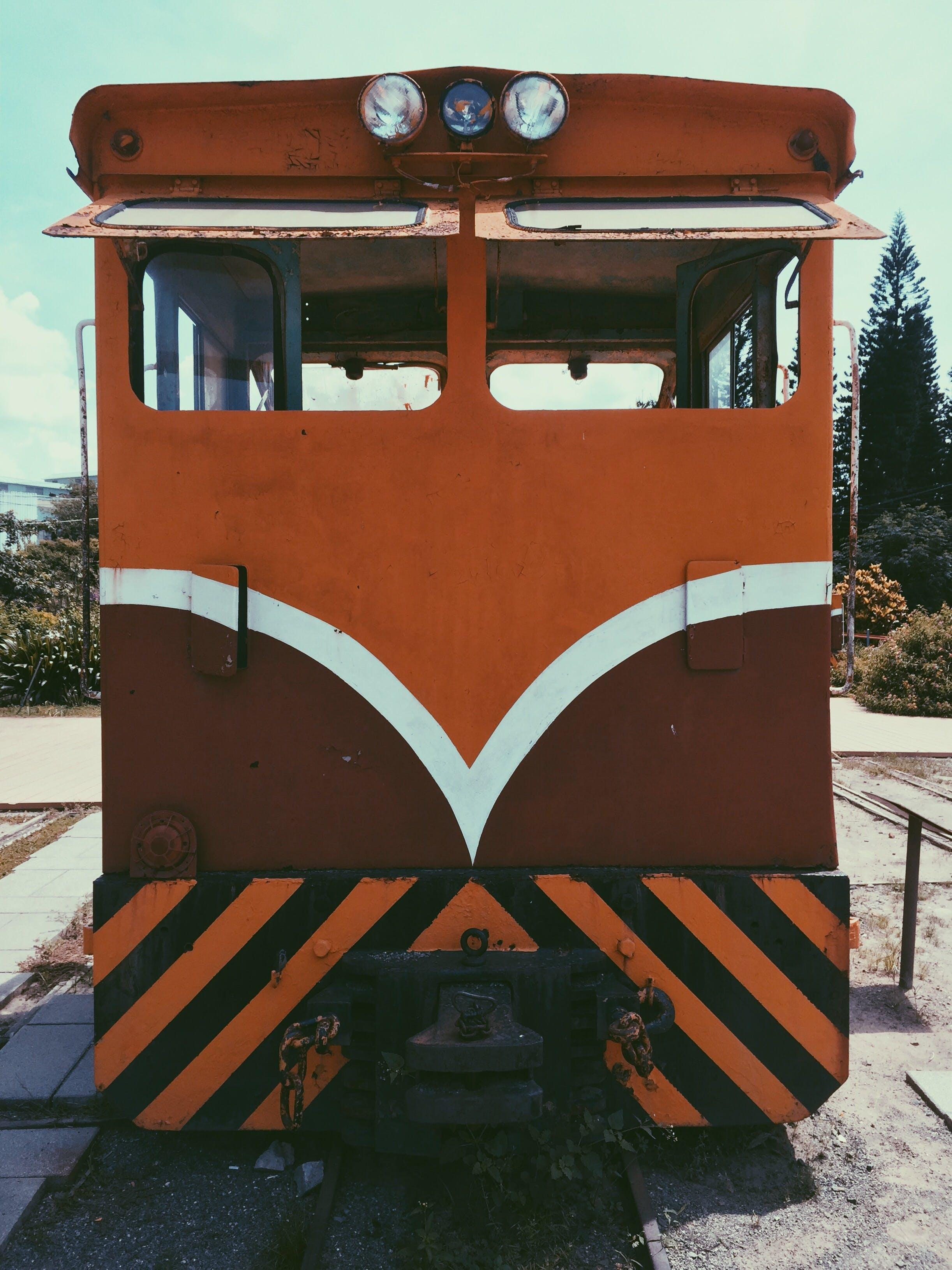 Orange, White, and Brown Train