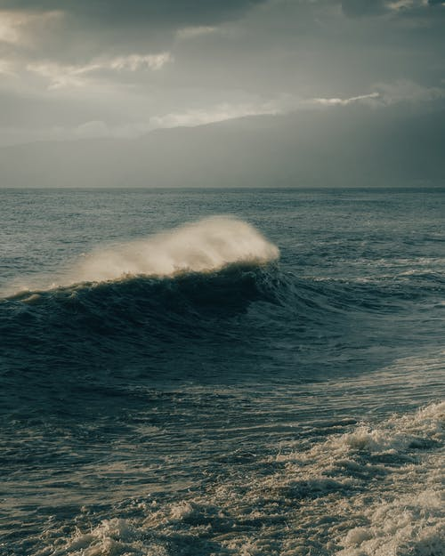 Ocean Waves Under White Clouds