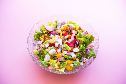 Close-Up Shot of a Delicious Vegetable Salad on a Glass Bowl