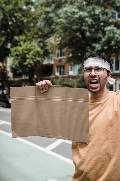 A Protester with a Cardboard Placard