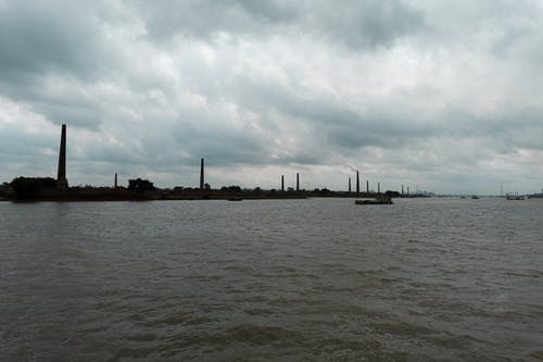 Free stock photo of big river, gray clouds, industrial area