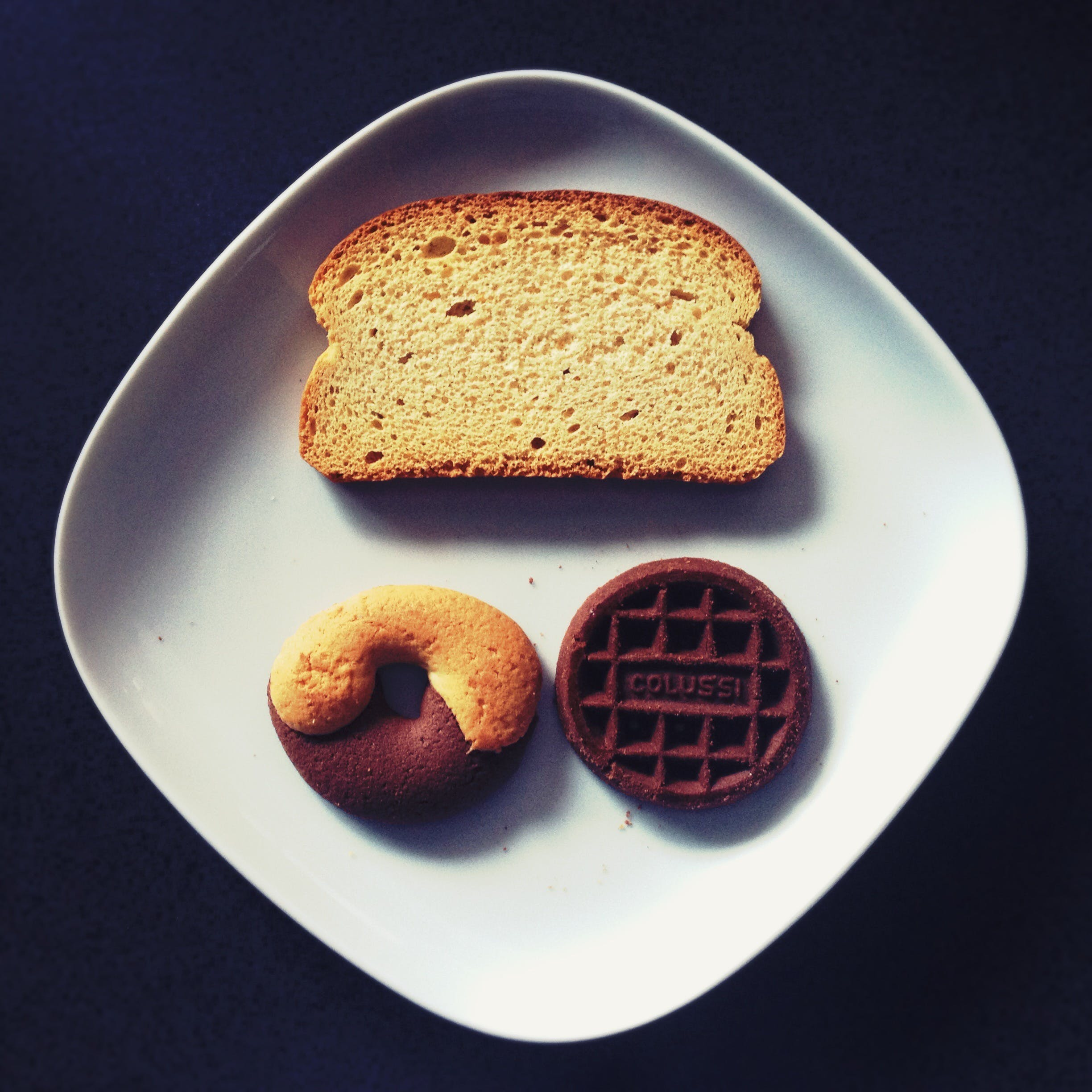 Toasted Bread, Donut, and Chocolate on Top of White Ceramic Plate