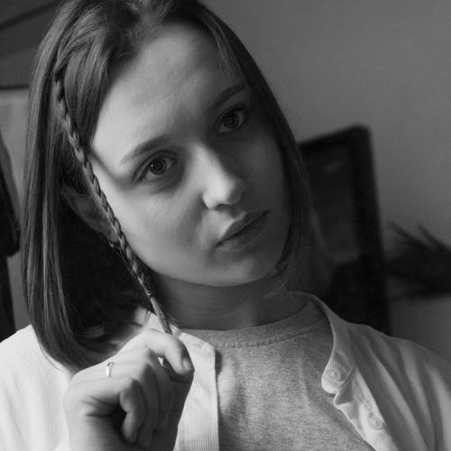Grayscale Photo of a Serious Woman