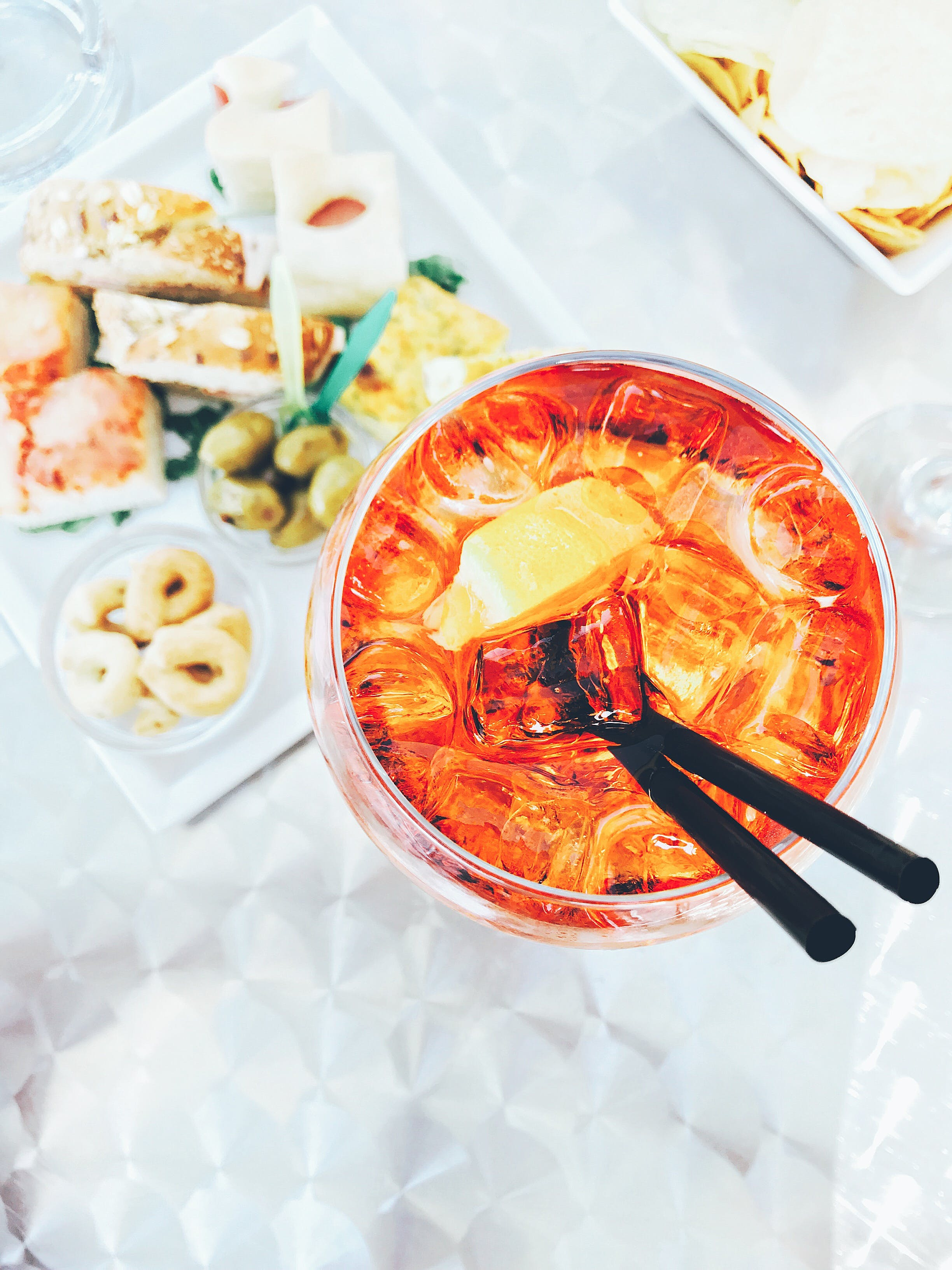 Photo Of Clear Drinking Glass Filled With Liquid Beside Food On Table