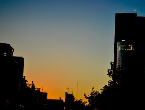 คลังภาพถ่ายฟรี ของ #sunset #buildings