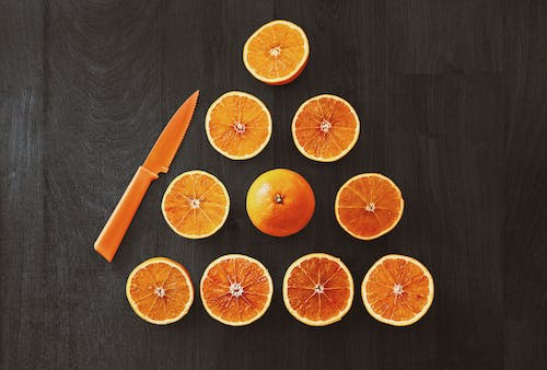 Sliced Orange Fruit With Knife