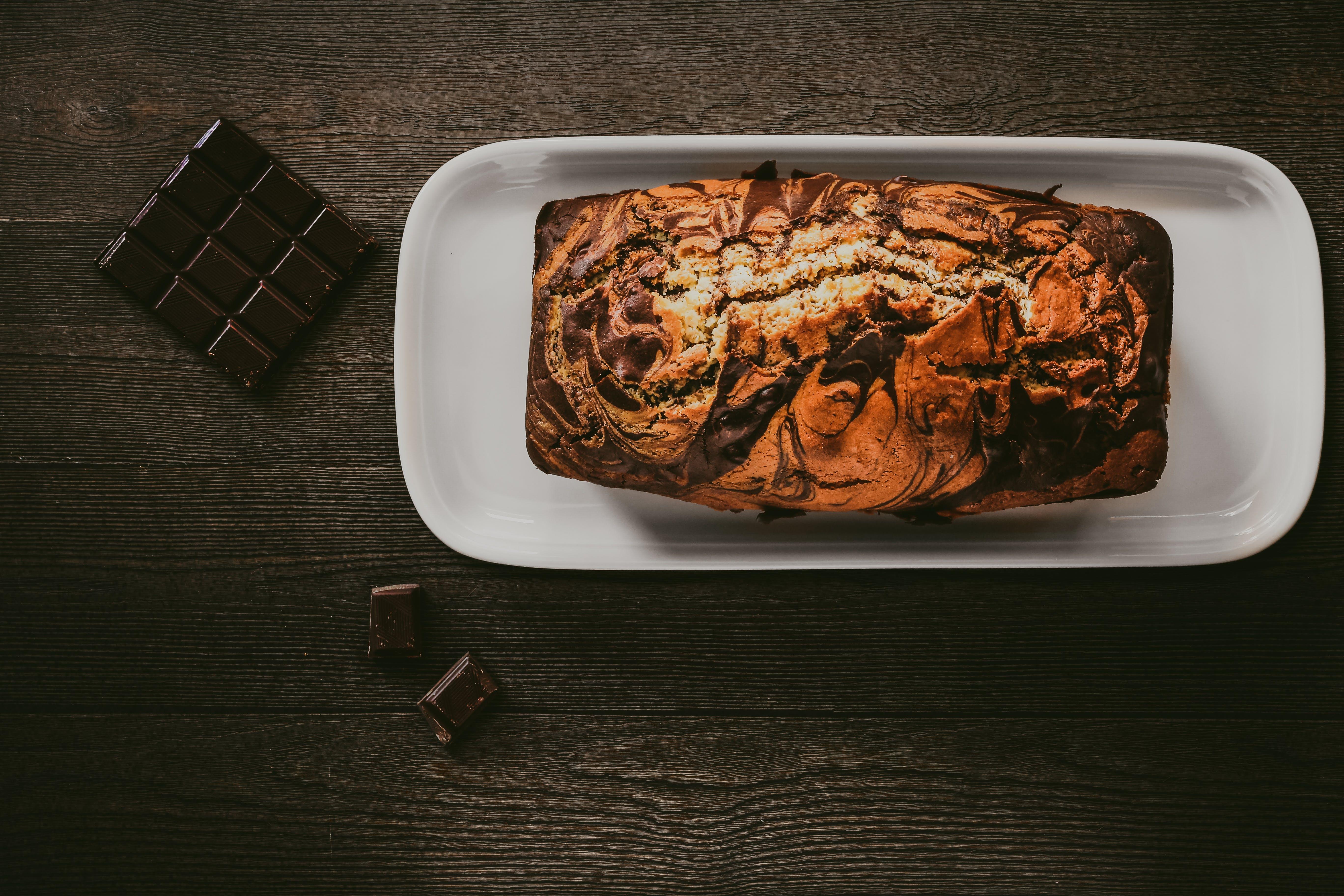 Chocolate Cake In White Plate Beside Chocolate Bars