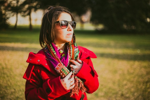 Woman In Red Coat With Black Sunglasses