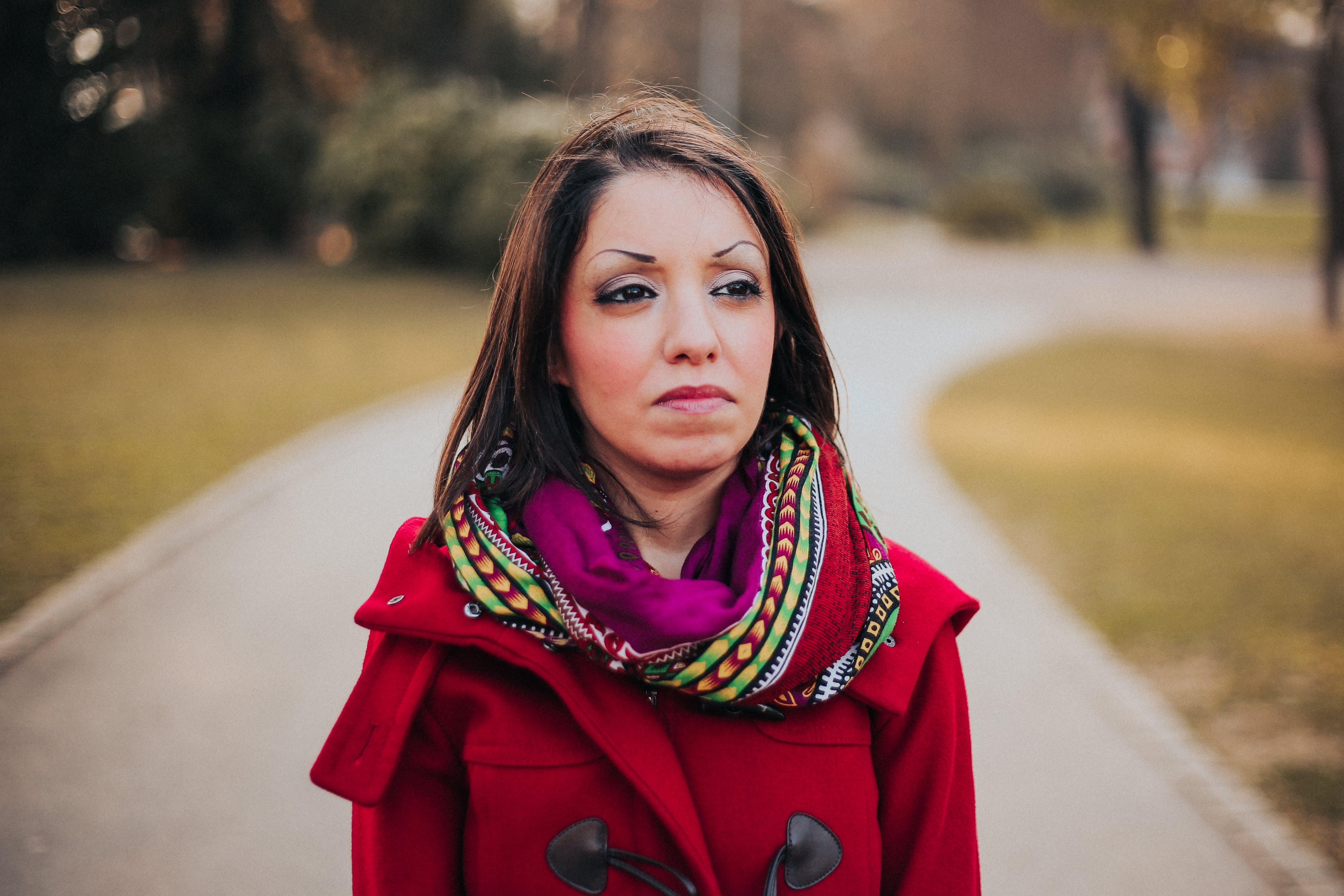 Woman Wearing Red Coat And Scarf