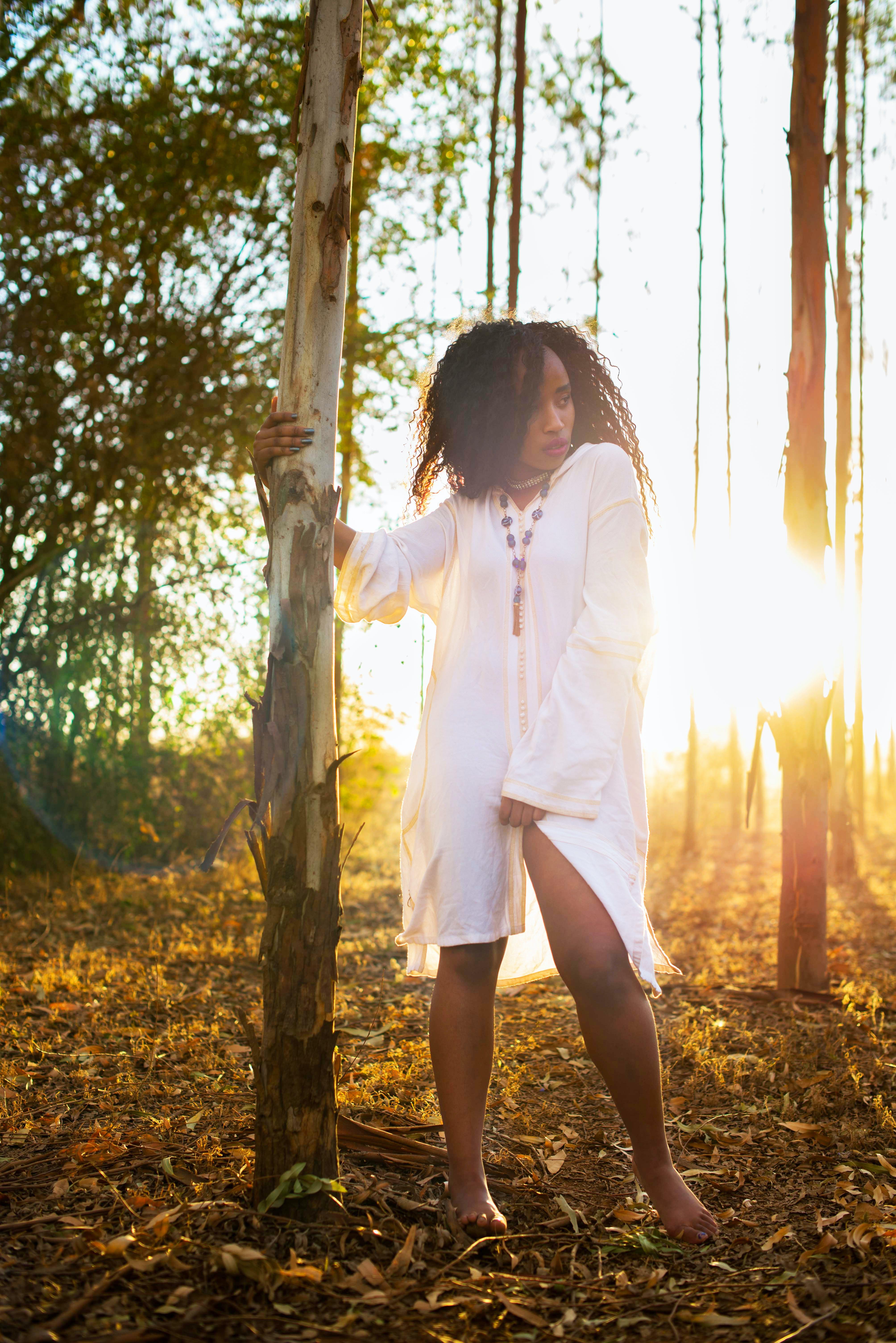 Woman Wearing Long-sleeved Shirt Standing Beside Tree