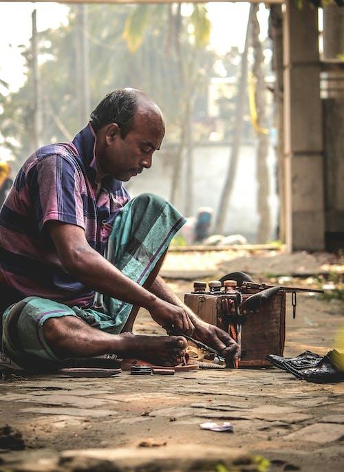 Fotos de stock gratuitas de artesanía, calle, herramientas, hombre