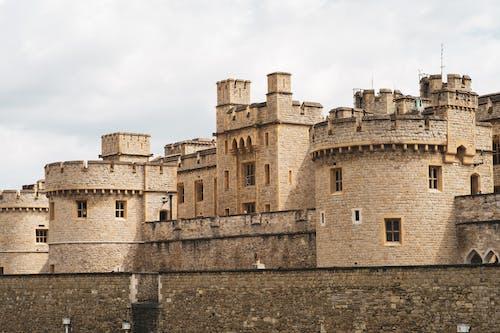 Ancient Brown Brick Castle Under White Clouds