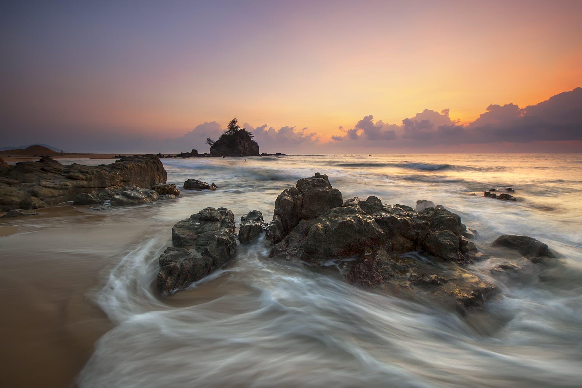 Stone in Seashore during Sunset