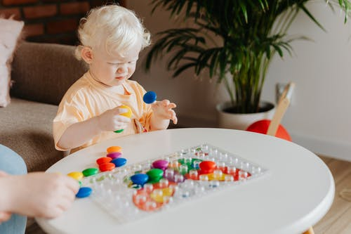 A Toddler Playing with Toys