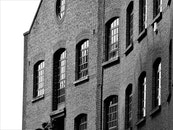 Brick Building Grayscale Photo