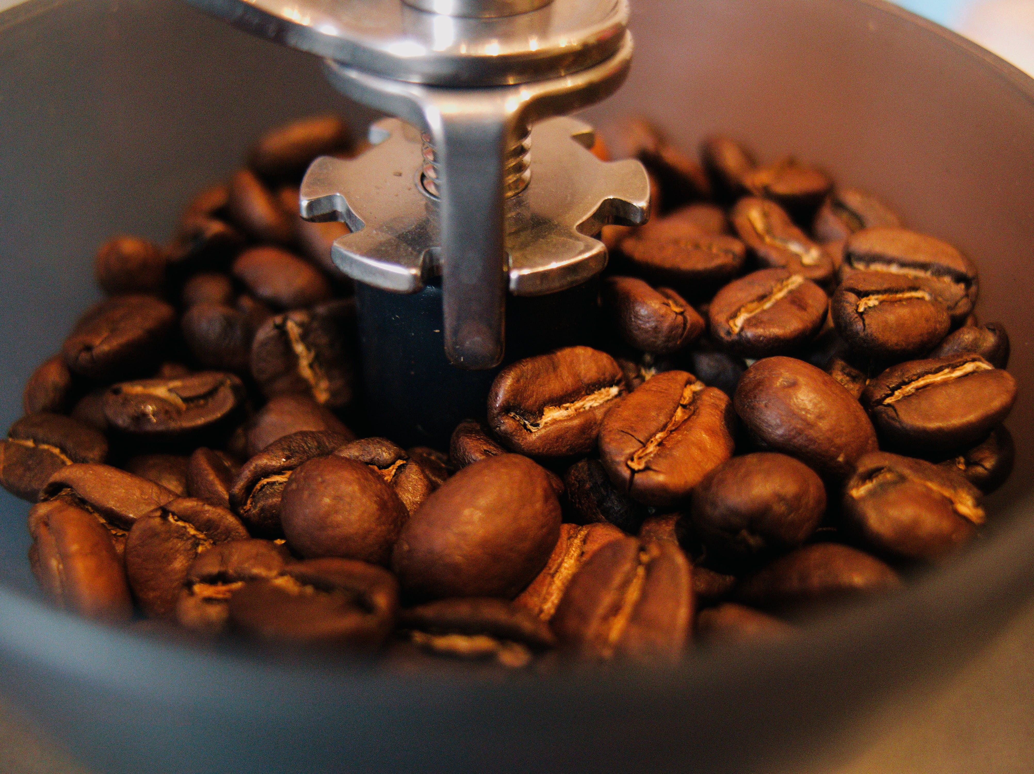 Black Coffee Beans in Grinding Machine