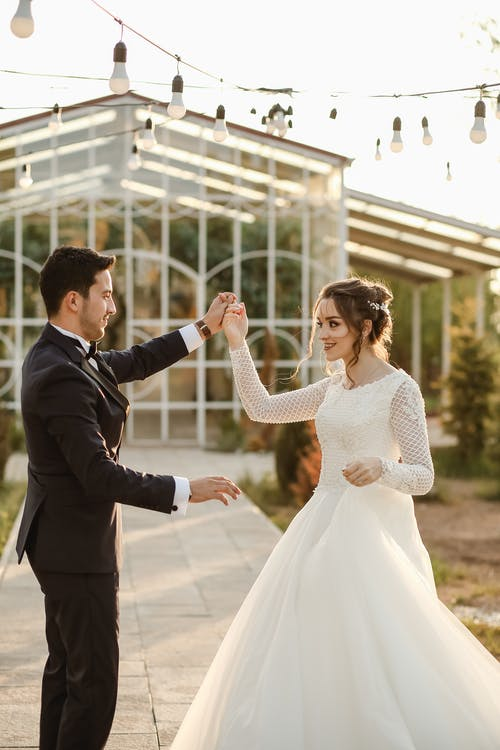 A Newly Wed Couple Dancing on Their Wedding