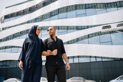Couple Standing in Front of a Modern Building