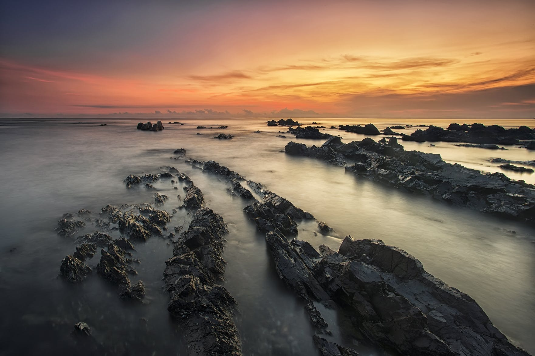 Rock Formation on Sea at Sunset