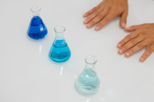 Erlenmeyer Flasks on White Table