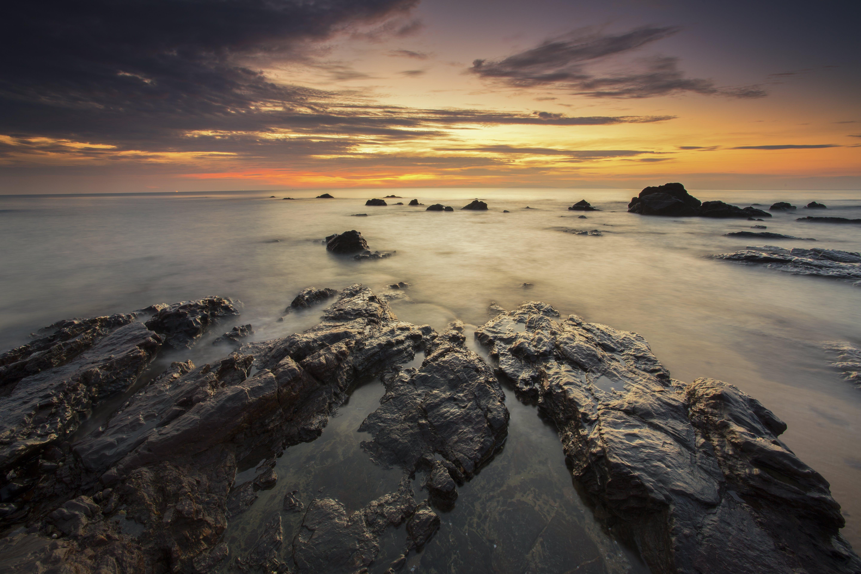 Brown Rock Formation Under Sunset