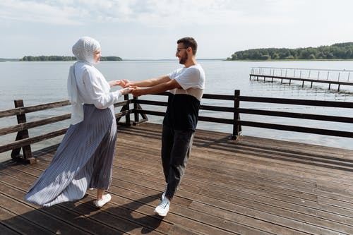 A Couple Dancing on a Wooden Dock