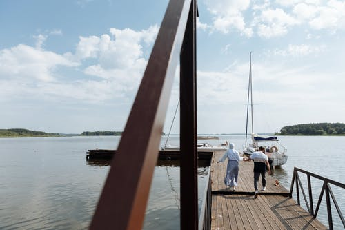 A Couple Running on a Wooden Dock