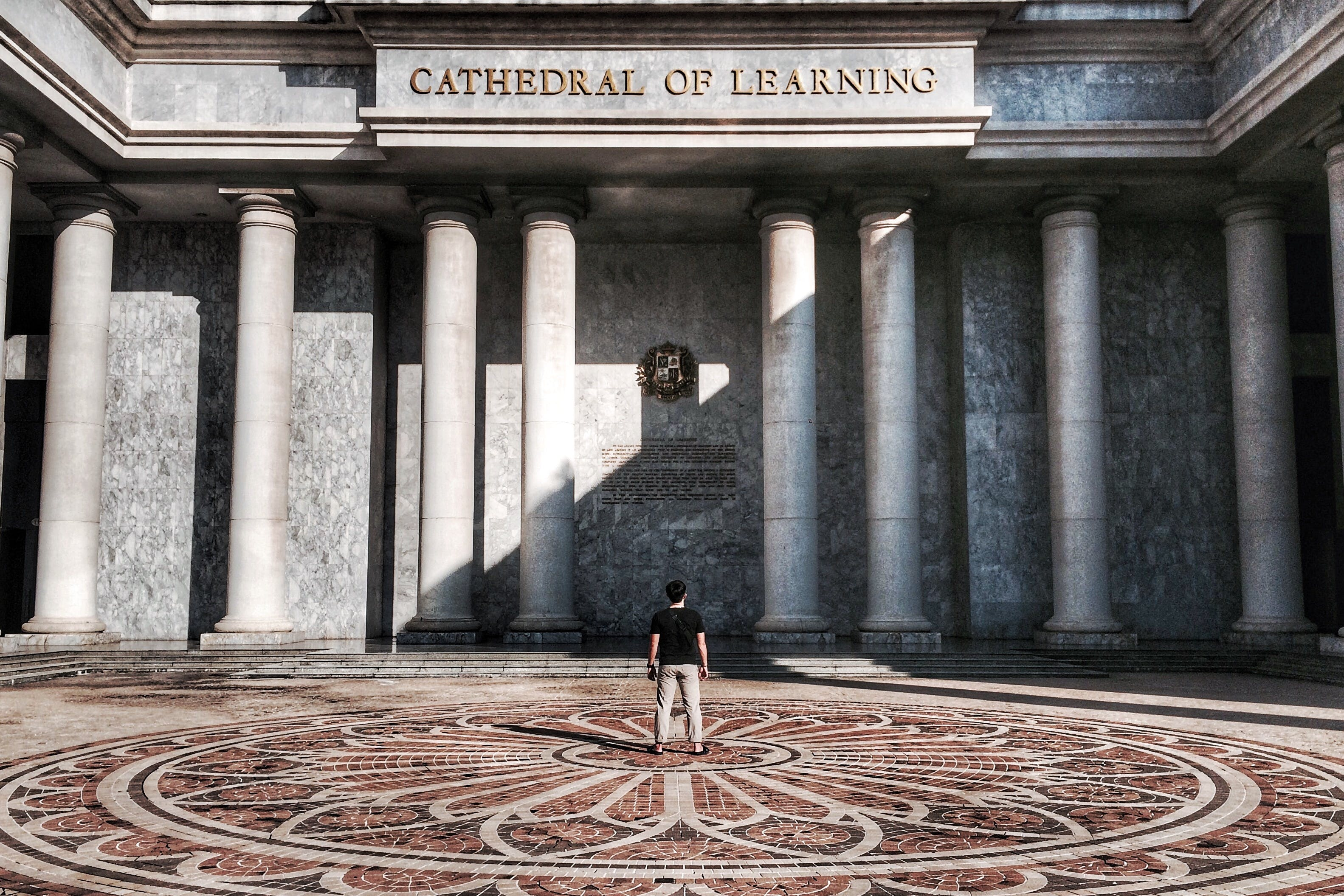 Photo of Person Standing in Front of Cathedral of Learning