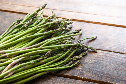 A Bundle of Asparagus on a Wooden Surface