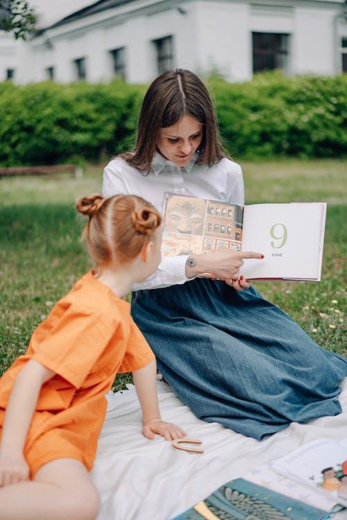 A Woman Teaching a Girl