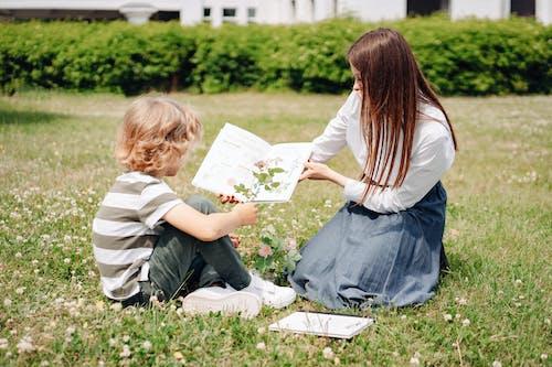 A Woman Teaching a Boy