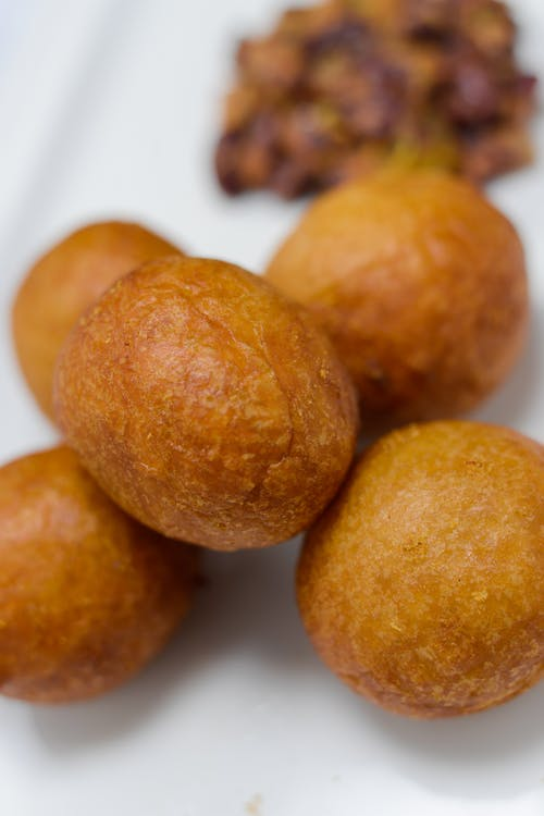 Round Fried Snacks on White Surface