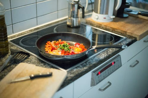Green and Orange Vegetables on Black Frying Pan