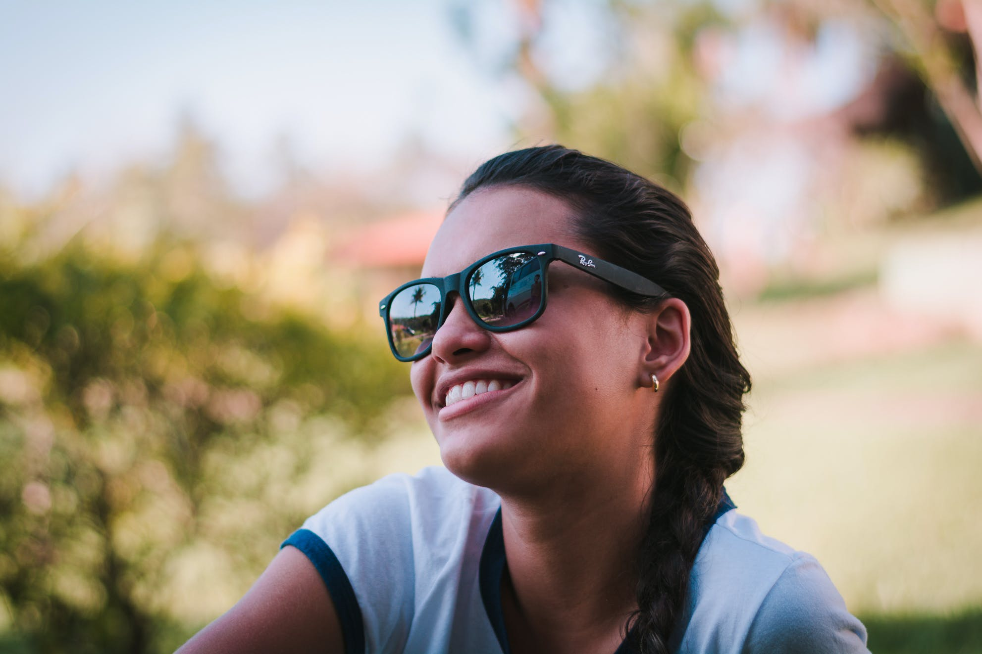 Woman Wearing Black Ray-ban Sunglasses
