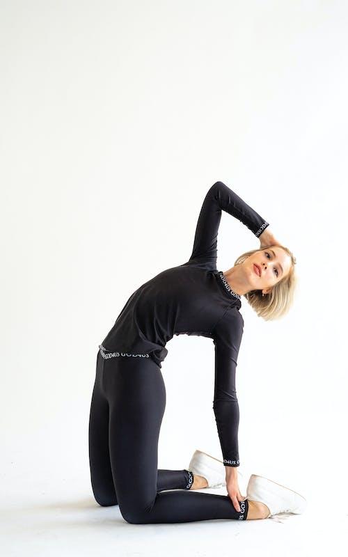 Flexible woman bending back in studio