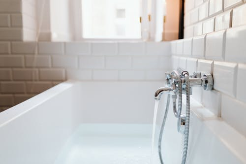 Stainless Steel Faucet Mounted on Ceramic Tiles