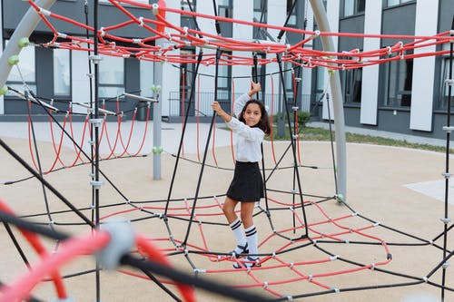 A Girl Playing in a Jungle Gym