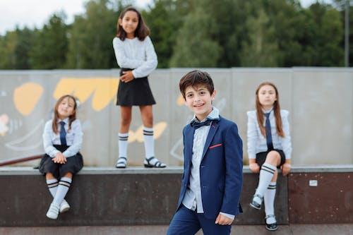 Happy Students Wearing Their School Uniforms