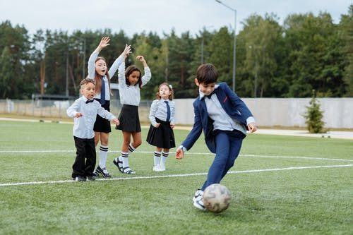 Group of Children Playing Soccer