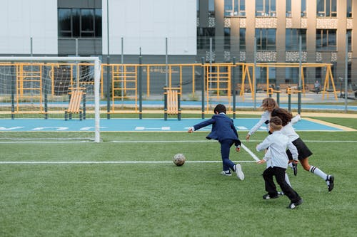 Children Having Fun Playing Soccer