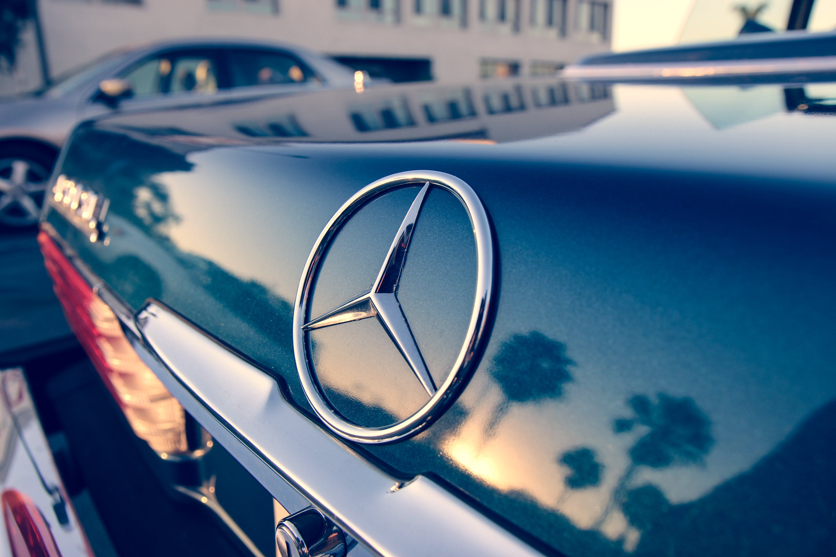 Close Up Photography of Chrome Mercedes-benz Car Emblem
