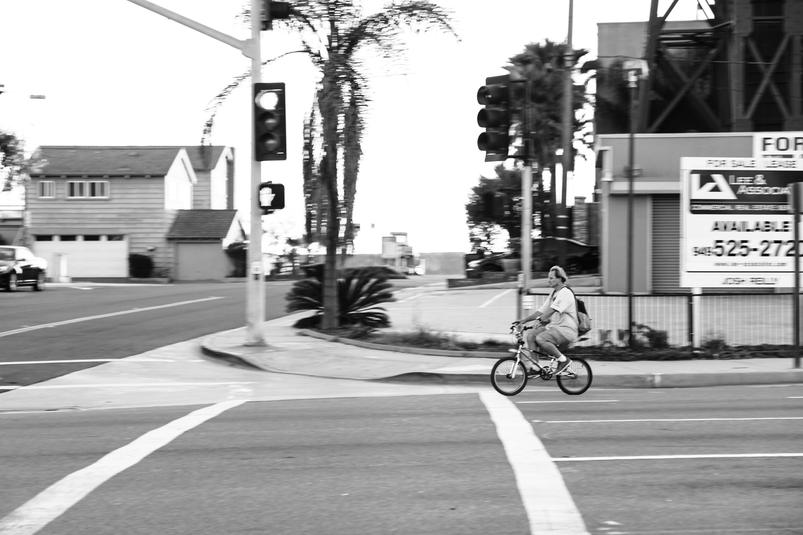 Man Riding Bicycle Photography