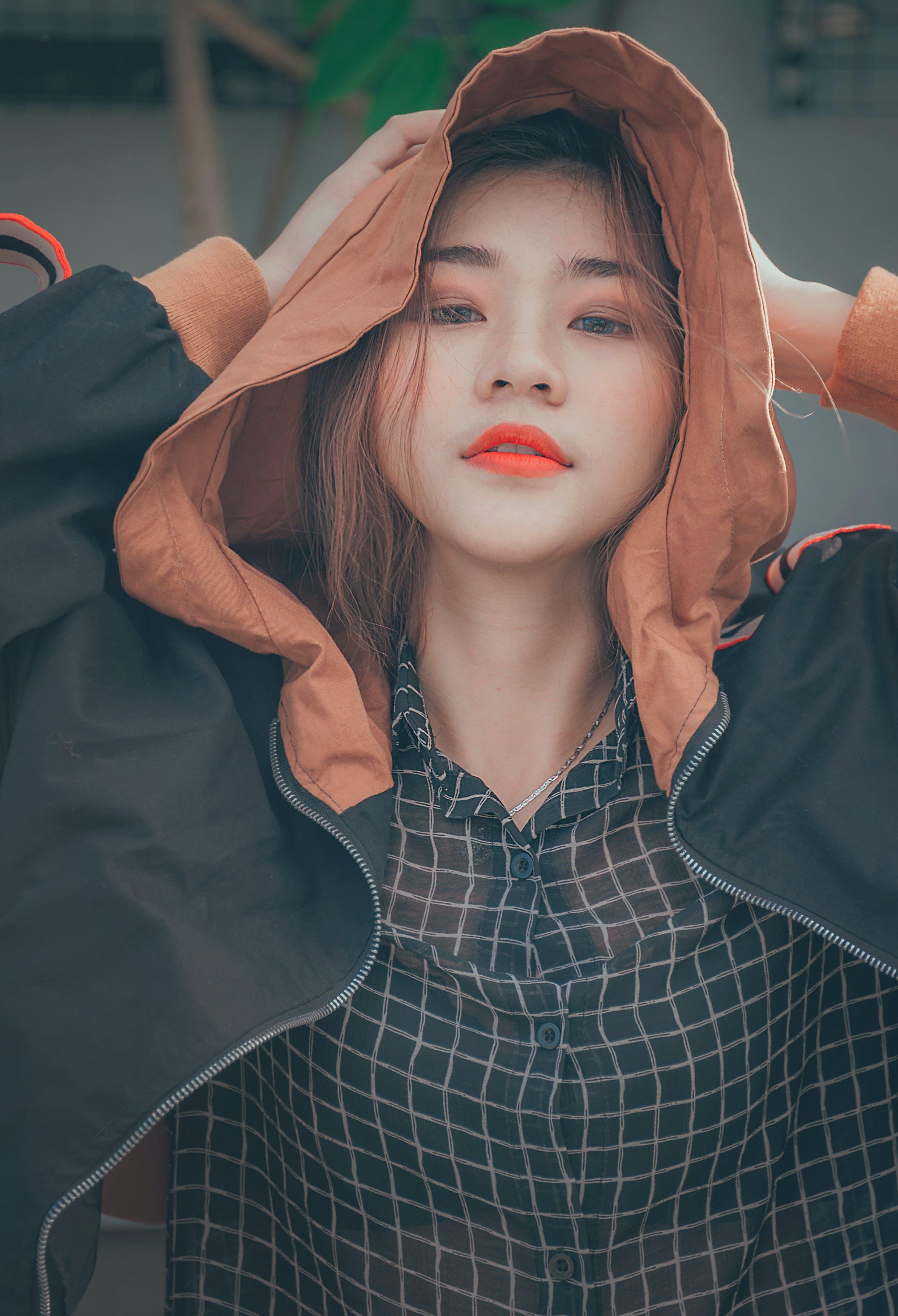 Woman Wearing Brown and Black Hoodie Jacket