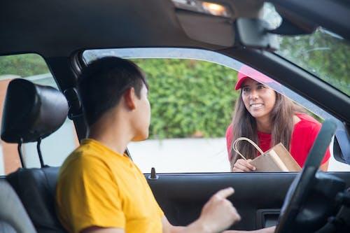 Man in Yellow Shirt Sitting inside the Car
