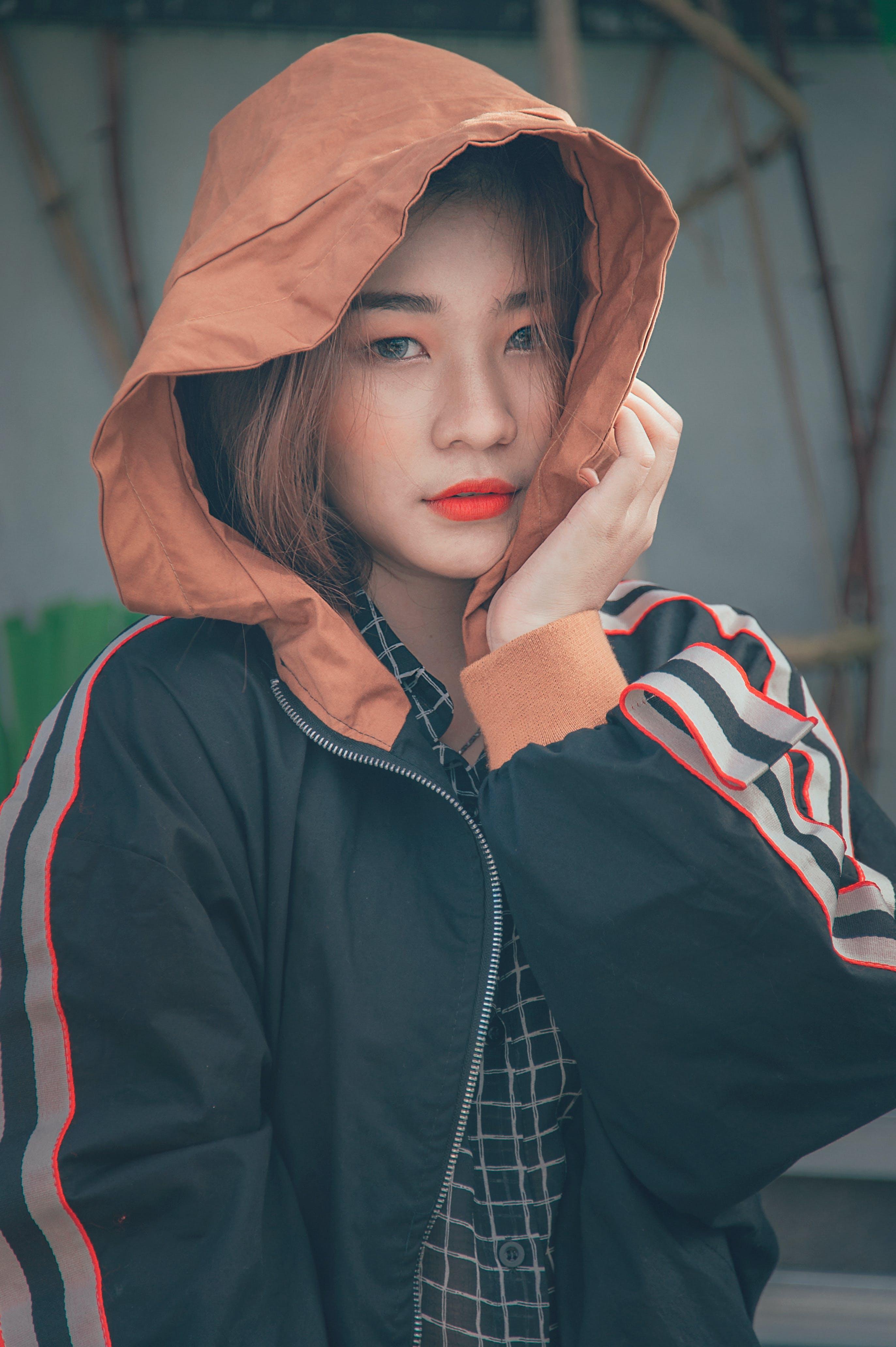Woman in Black and Orange Zip-up Hoodie