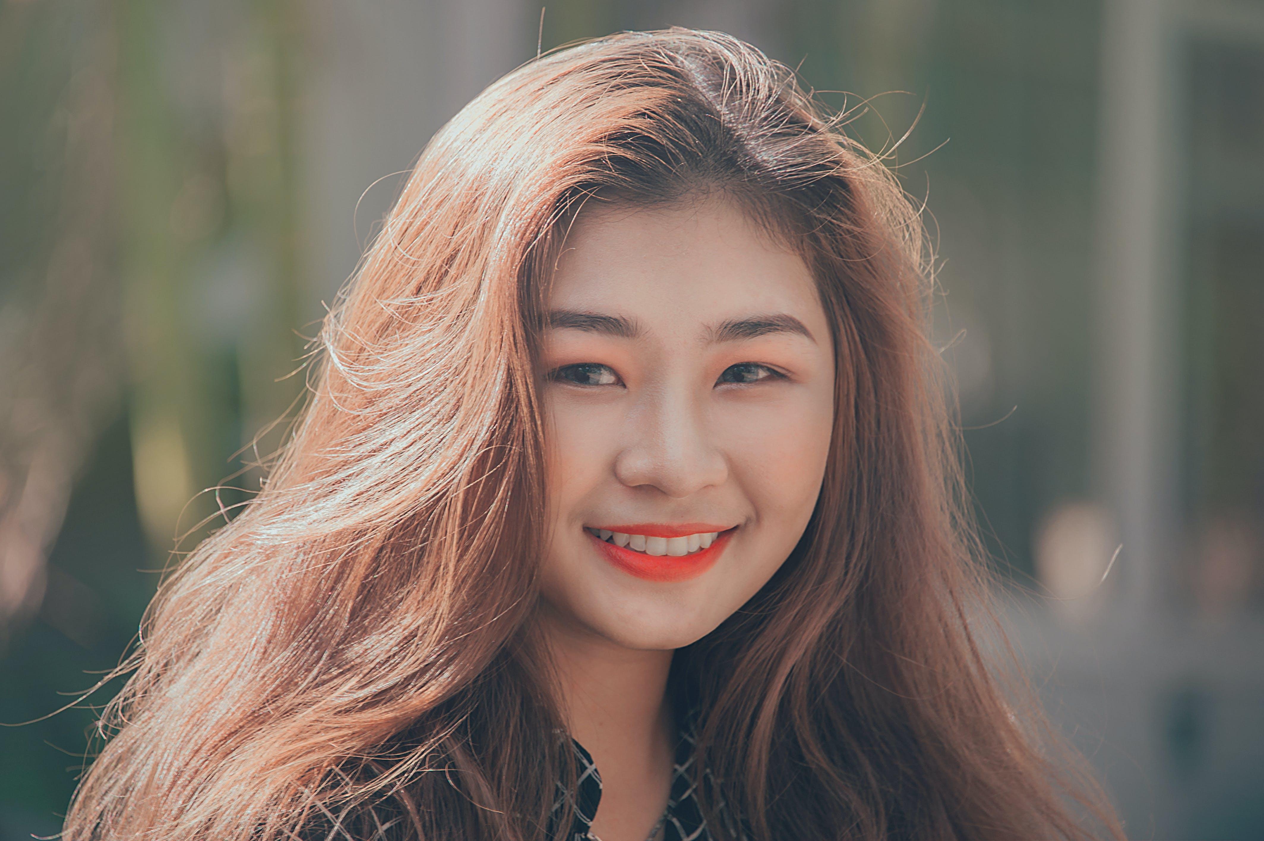 Woman Smiling Wearing Red Lipstick
