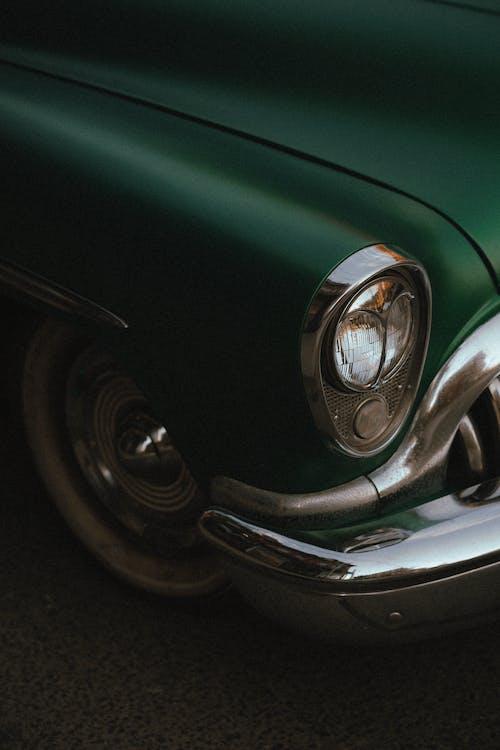 Green Car With Chrome Wheel